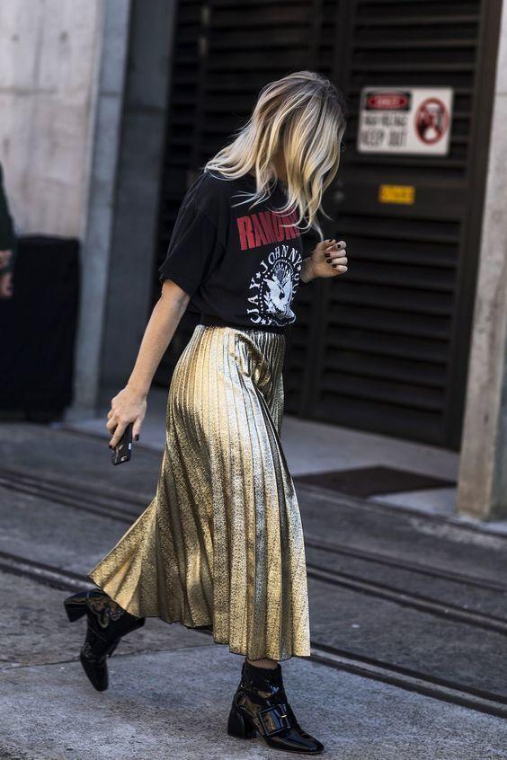 Band tee and a metallic skirt.: