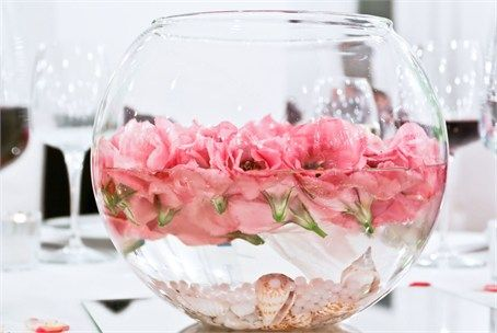 This idea is fantastic for a beach themed wedding - or a celebration taking place after a wedding abroad. Adding a collection of sea shells and pearls to the bottom of the bowl before adding water and flowers can have an incredible effect, making your table decorations appropriately themed in association with your destination wedding.