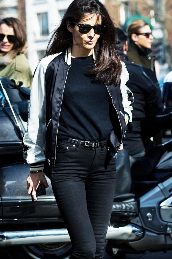 A two-toned bomber jacket is paired with a simple black tee and black skinny jeans