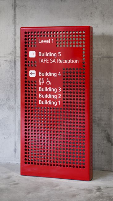 perforated totem with directional signage