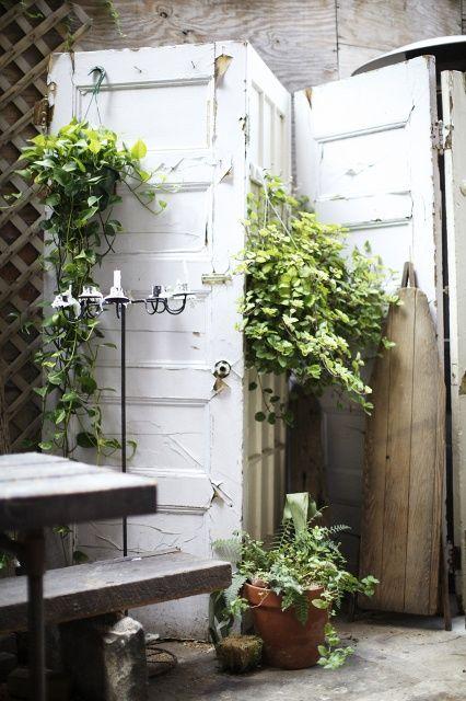 Use old doors and windows as a garden screen.