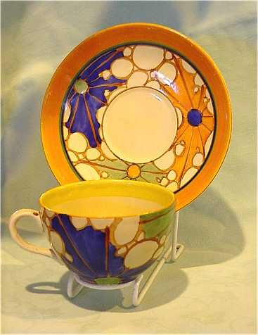 Clarice Cliff orange Broth Globe cup and Saucer