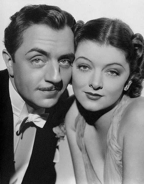 "William Powell & Myrna Loy as Nick & Nora Charles in the ""Thin Man"" movies."