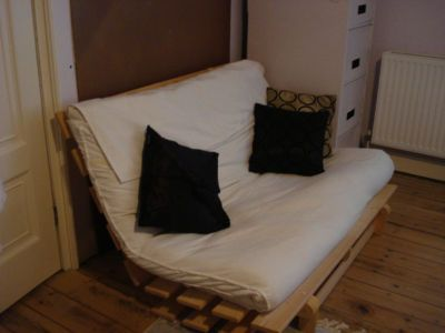 ikea futon instead of a full size bed guest room. Black Bedroom Furniture Sets. Home Design Ideas