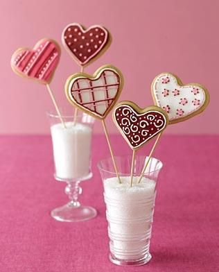 These are really well decorated iced cookie hearts on a popsicle stick..