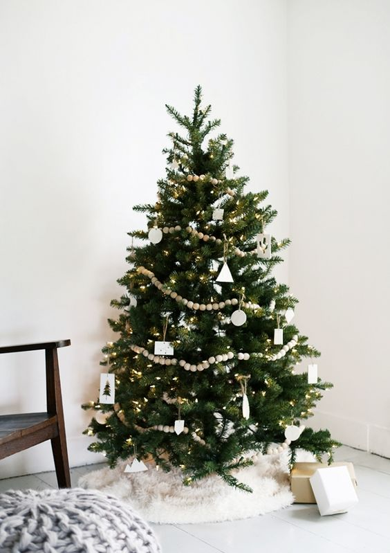 50 Christmas trees fully decorated from top to bottom featuring a variety of Christmas themes.: