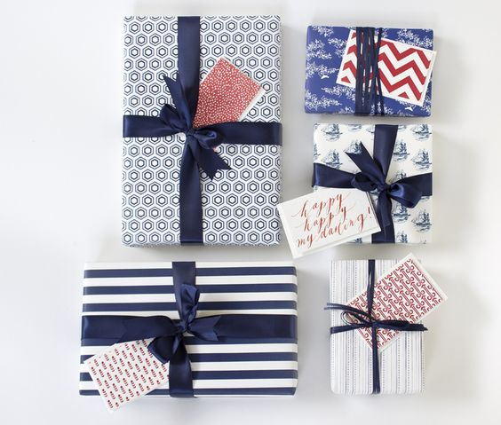 Nice gift wrap ideas. Love the crisp lines of the navy and white; the red is a nice pop of color.