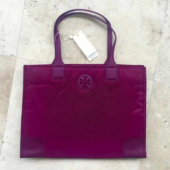 Tory Burch Ella Packable Tote in Shiraz NWT Authentic. Brand new with tag and dust bag. Nylon water proof. Color Shiraz. Zipper closure. 2 interior pockets. Can be folded and packed. No Trade Tory Burch Bags Totes