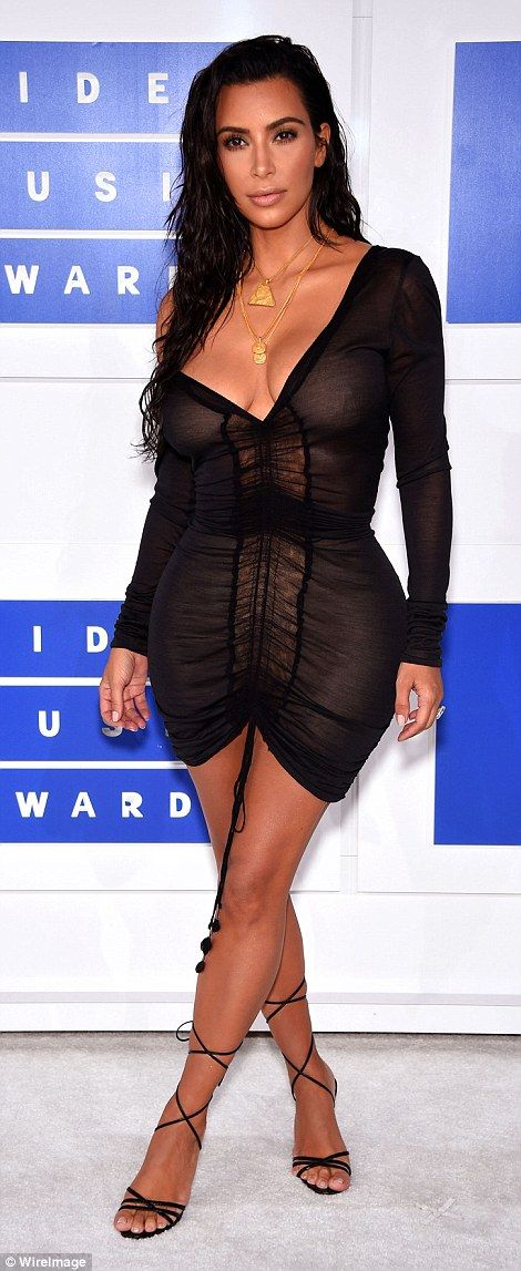 So sexy:Completing her look, Kim wore her dark hair tousled and wet, in contrast to her f...