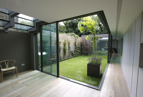 The minimal windows slide away from the corner to create for Minimalist house with courtyard