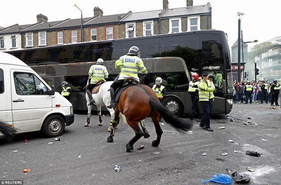 The sight of police  shielding the United team bus comes ahead of West Ham's final game at Upton Park