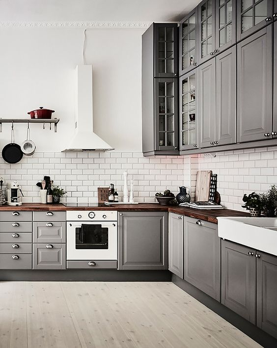 These gray cabinets are huge, so you get plenty above and below. You also get dark wood countertops to provide a great balance. It looks a little darker but a whole lot of fun.