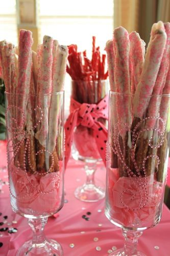 I always love a good edible centerpiece.  These are chocolate-dipped pretzels in dollar store vases with candlestick bottoms glued on.