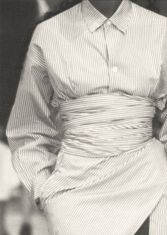 cotonblanc: Summer 1986Cour Carrée du Louvre Asymmetry breaks the rules for white and striped shirts. Being oversized, they wrap, tie together, and sculpt a body with broken-offset lines. An exercise of style that generously embraces two cultures. Talking to Myself, Edited by Carla Sozzani and Yohji Yamamoto: