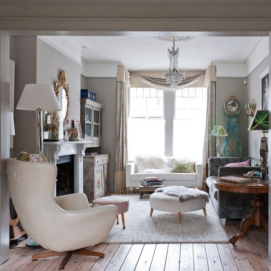 Grand living room  Colour and comfort are vital ingredients in this living room. The rug and the sofa are contemporary features, while the ornate chandelier and gilded mirror add a vintage-feel #housetohome