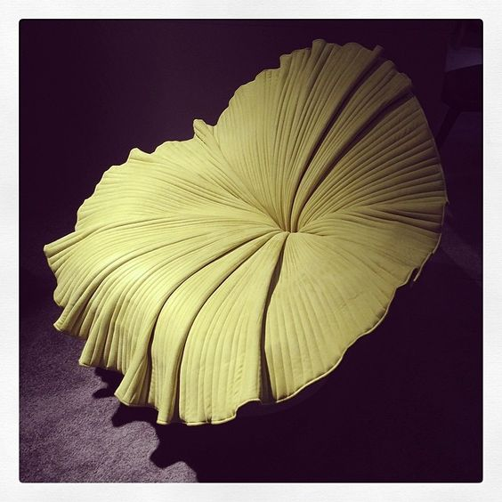 Bright yellow Bloom chair by Kenneth Cobonpue.