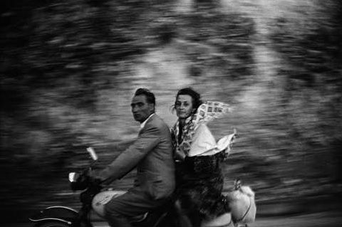 """Couple astride a scooter. From the """"European Trip: Photographs from the Car"""" series, Greece, Rt. E87, near Trokala. Meyerowitz shot from his car as he drove across Europe in 1967 and 1967. Featured on 1stdibs' article about the Joel Meyerowitz show at Howard Greenberg."""