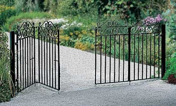 Marlborough Bi Fold Wrought Iron Metal Driveway Gates - This design is perfect if your property has limited space for parking or where the ground slopes across the entrance.