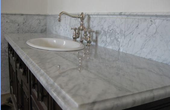 carrera marble countertops - in master bath,bath #2, powder bath