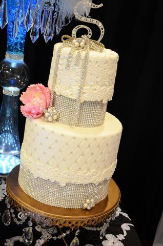 Lace applique wedding cake with rhinestone separators and quilting with rhinestone studs by Love Is In the Air.  www.loveisintheairevents.com
