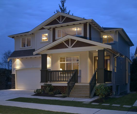 This home has all the makings of a true American classic with the white garage, small porch in front and stairs leading up to the front door.