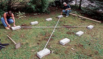 Eight Solid Concrete Blocks Are Arranged In Two Rows To
