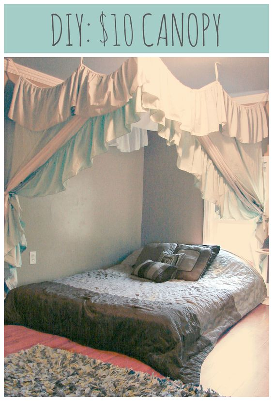 DIY: $10, 1 Hour Canopy: 2 Bed Sheets, 2 Bed Skirts, a Spool of Cheap Ribbon, and a Staple Gun.