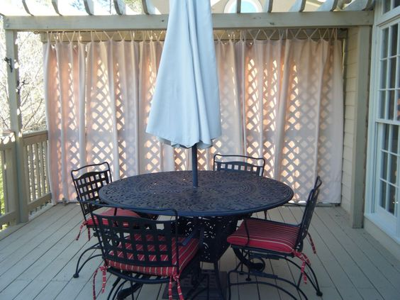 """Love the """"privacy curtain"""" infront of the latticework!"""