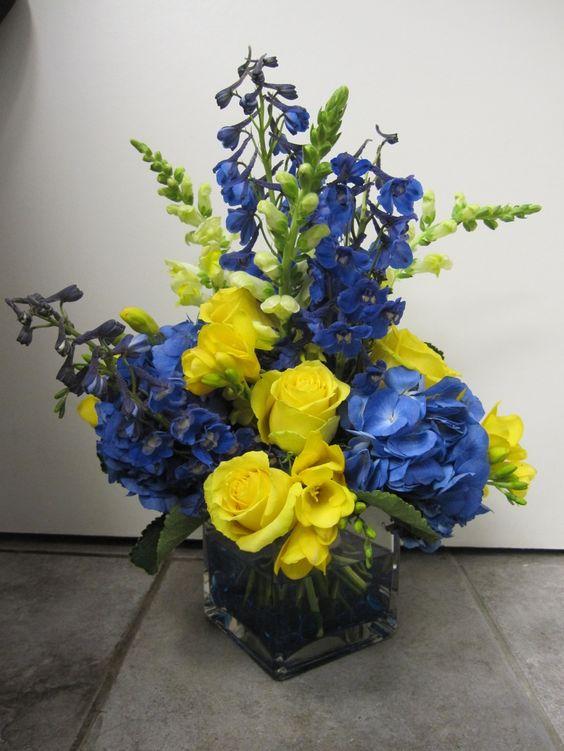Wedding Flowers By Island Petals Blue Flower Arrangements Flower Centerpieces Wedding Yellow Centerpieces