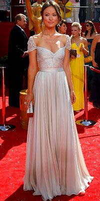 Olivia Wilde her Reem Acra gown with jewel-encrusted cap sleeves at the 60th Primetime Emmy Awards in 2008.