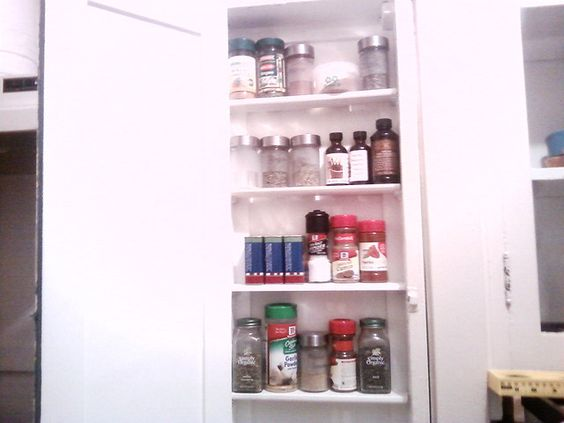 DIY project of the evening: ironing board cabinet to spice rack! by How I See Life, via Flickr: