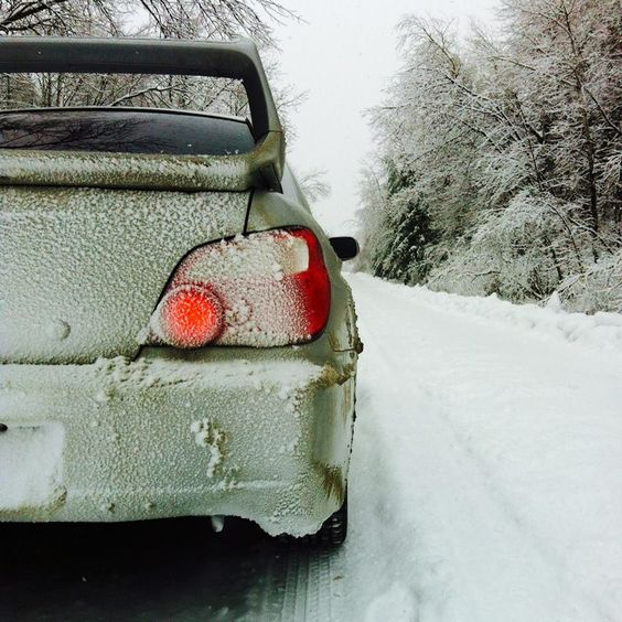 subaru sti in deep snow