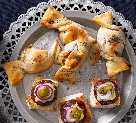 Christmas party finger food. Brie and cranberry parcels with chopped walnuts.