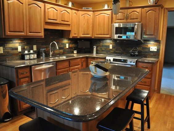 uba tuba on oak cabinets with backsplash  1×1 trans Uba Tuba Granite