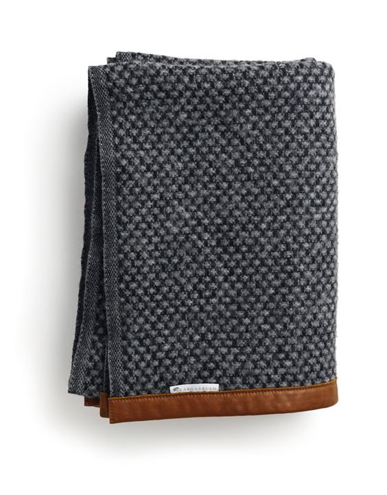 Sophisticated knit with bound edges in this lovely deep charcoal colour but all doable for home knitters!