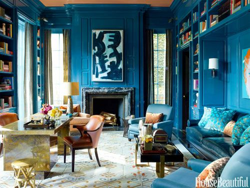 Walls in a custom peacock-blue lacquer by Fine Paints of Europe give depth and richness to the library of a Chicago townhouse.