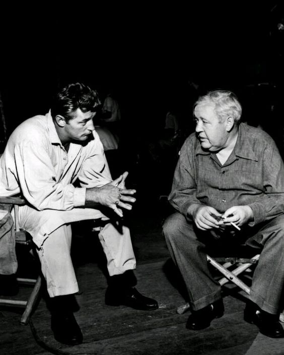 Robert Mitchum and Charles Laughton on the set of 'The Night of the Hunter'