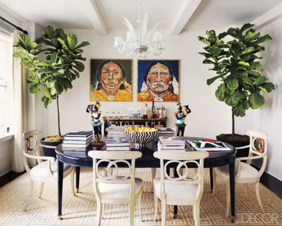 symmetrical fig leaf trees in a dining room.