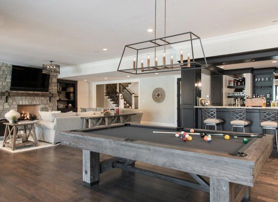 Give your unfinished basement a new lease on life. With the help of designers, these homeowners turned their drab basements into stylish entertainment and relaxation destinations. Forget TV rooms, dens, and guest suites. These inspired hideaways are the new look for finished basements. #basementremodel