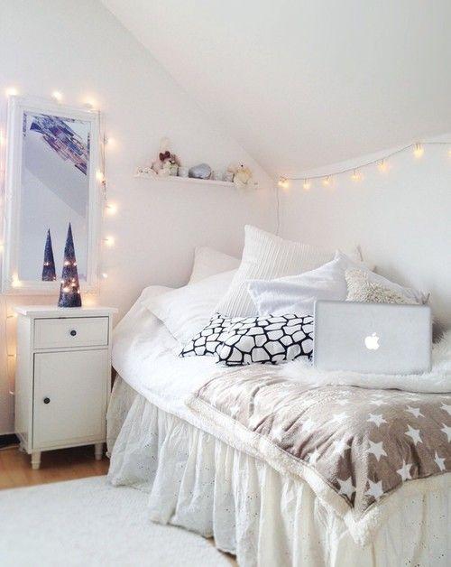 White bedroom. Love the lights.: