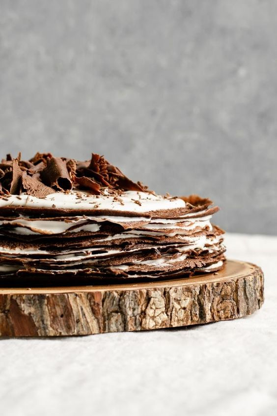 A delicious vegan dark chocolate crepe cake is made with chocolate beer crepes and has a whisky whipped cream filling. This dessert is a showstopper!