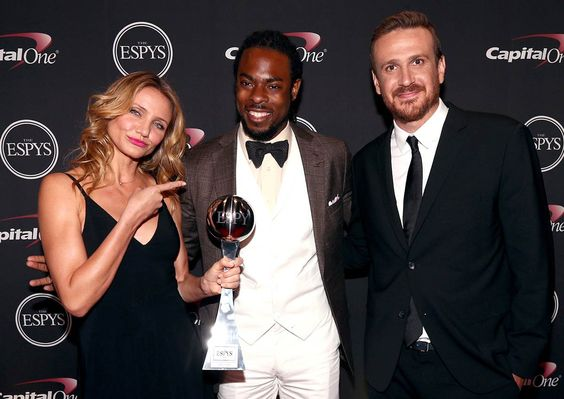 Cameron Diaz and Jason Segel, right, pose with Seahawk Richard Sherman and his award for best breakthrough athlete at the 2014 ESPYS at Nokia Theatre L.A. Live in Los Angeles on July 16, 2014