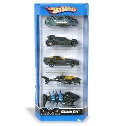 """5-Car Gift Pack:Hot Wheels: Gotham City by Mattel. $12.99. Take to the streets with five Gotham-City-themed Hot Wheels cars. This Gift Pack includes five 1:64-scale die-cast vehicles with unifying themes, all in one package. It's an instant collection! Vehicles not for use with select Hot Wheels sets. Each vehicle measures 3"""" long."""