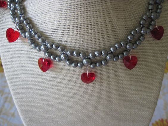 Gray Glass Pearl Weave/ Woven Necklace Pattern with Dangling Hand Wrapped Red Ruby Crystal Hearts $33.00 #weddings #jewelry #necklace #bridesmaid #gifts #gray #grey #woven #beadweaving #bridal #accessories #ruby #red #ruby_red #holiday #christams #prom #valentines_day #romantic #genuine_crystals #handwrapped #toggle_clasp #pearls #etsyfollow