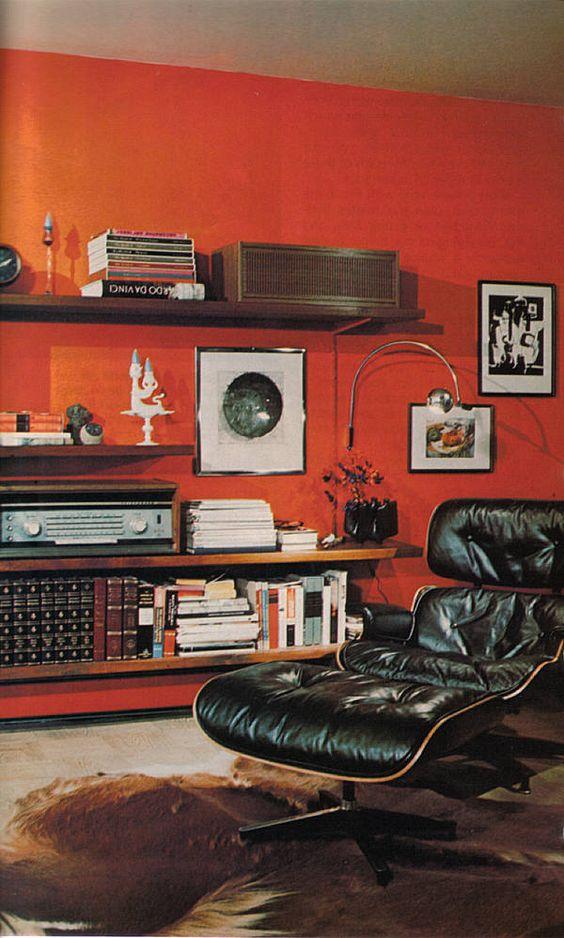 Cozy retro man cave w/ Eames chair, animal hide rug, art, books & hi fi-- Done.