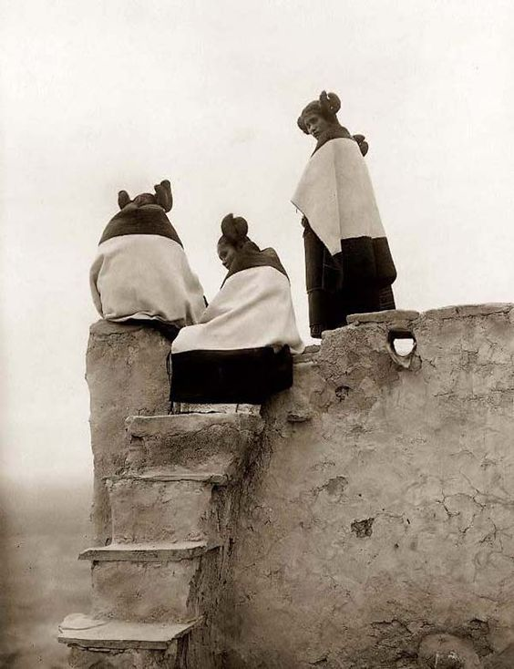 You are viewing an unusual image of Three Hopi Women on top of an Adobe House. It was taken in 1906 by Edward S. Curtis.    The image shows a stunning view of these Native American Women.
