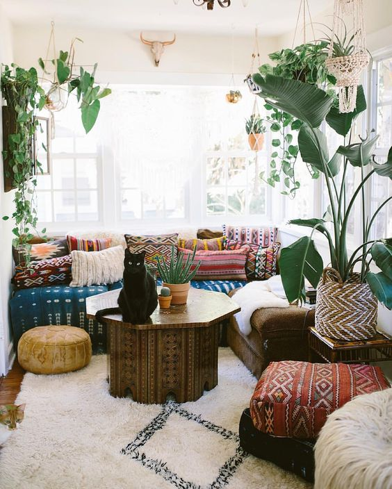 Look at all these gorgeous textiles ...! Boho cozy corner