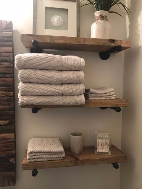 Farmhouse Style Bathroom With Open Industrial Wood Shelving Wire Baskets Glass Jars And F Small Bathroom Decor Diy Shelves Bathroom Farmhouse Bathroom Decor