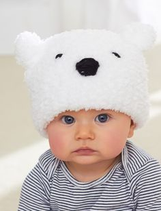Free knitting pattern for Lil Polar Bear Hat - Bernat's easy baby hat is suitable for beginners. Sized for 6/12 mos and 18/24 mos.