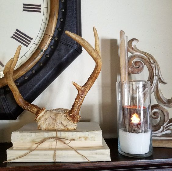 Rustic winter mantel antlers old books corbel neutral mantel hygge decor